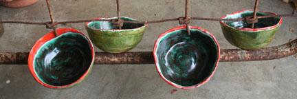 4 orange-rimmed bowls
